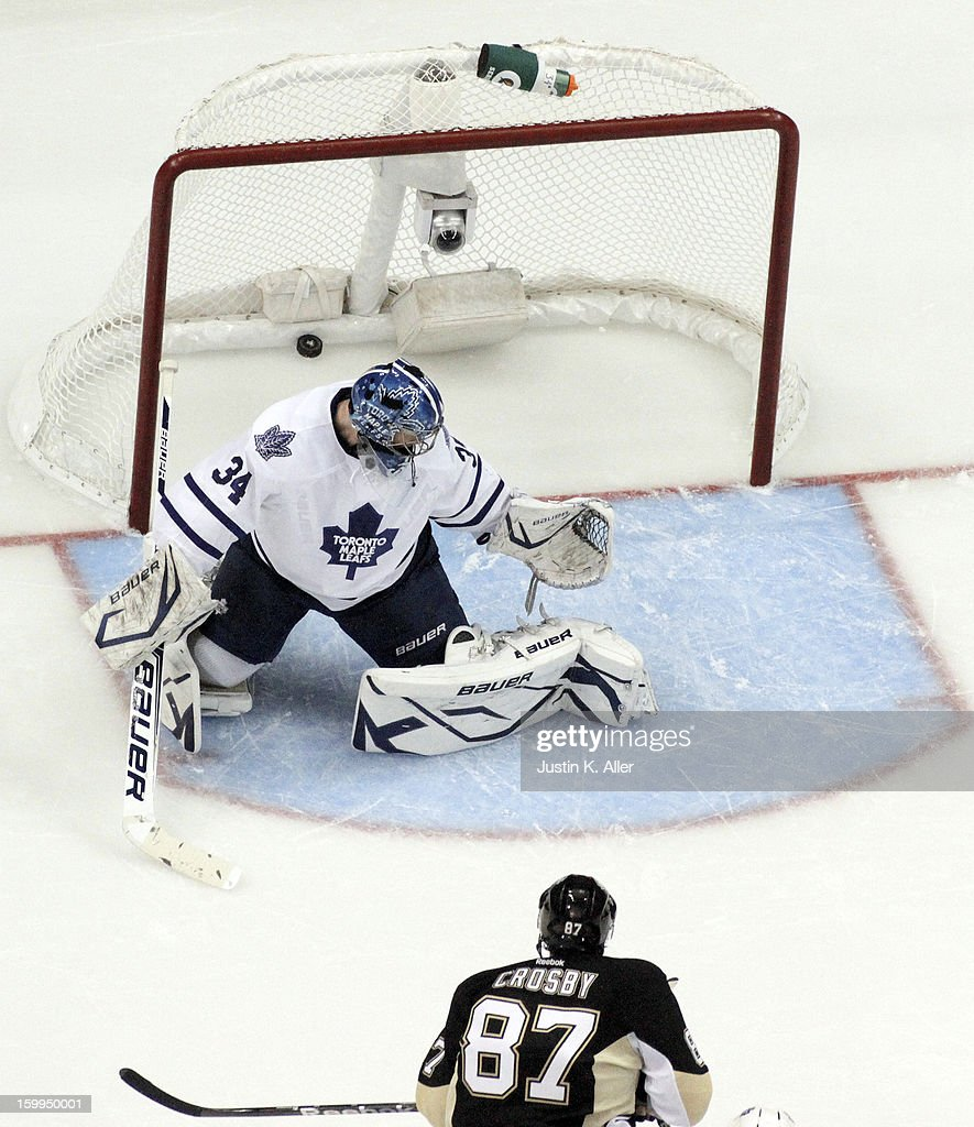 <a gi-track='captionPersonalityLinkClicked' href=/galleries/search?phrase=Sidney+Crosby&family=editorial&specificpeople=212781 ng-click='$event.stopPropagation()'>Sidney Crosby</a> #87 of the Pittsburgh Penguins scores past James Reimer #34 of the Toronto Maple Leafs during the game at Consol Energy Center on January 23, 2013 in Pittsburgh, Pennsylvania. The Leafs defeated the Pens 5-2.