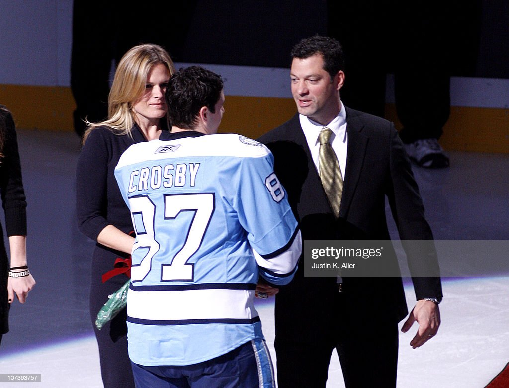 Sidney Crosby of the Pittsburgh Penguins shakes hand with Bill Guerin who was being honored on his retirement from the Penguins prior to a game...