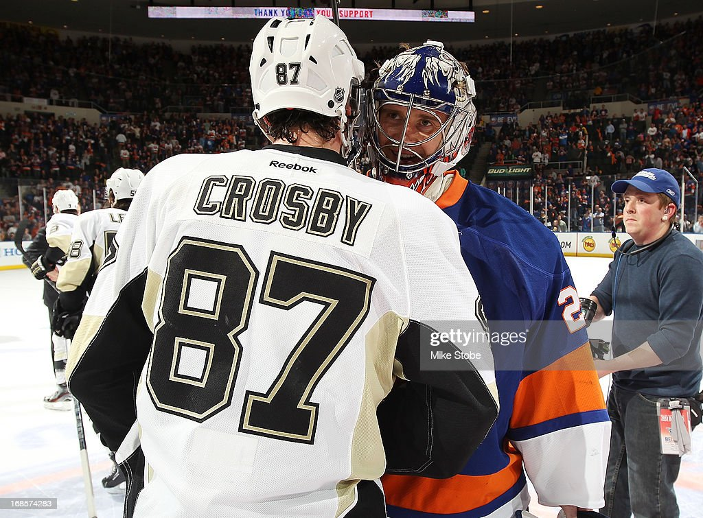<a gi-track='captionPersonalityLinkClicked' href=/galleries/search?phrase=Sidney+Crosby&family=editorial&specificpeople=212781 ng-click='$event.stopPropagation()'>Sidney Crosby</a> #87 of the Pittsburgh Penguins shakes hands with <a gi-track='captionPersonalityLinkClicked' href=/galleries/search?phrase=Evgeni+Nabokov&family=editorial&specificpeople=171380 ng-click='$event.stopPropagation()'>Evgeni Nabokov</a> #20 of the New York Islanders in Game Six of the Eastern Conference Quarterfinals during the 2013 NHL Stanley Cup Playoffs at Nassau Veterans Memorial Coliseum on May 11, 2013 in Uniondale, New York. The Pittsburgh Penguins defeated the New York Islanders 4-3.