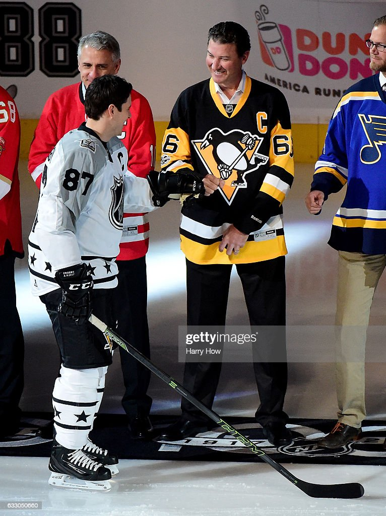 Sidney Crosby #87 of the Pittsburgh Penguins shakes hands with former NHL player Mario Lemieux prior to the 2017 Honda NHL All-Star Game Semifinal #1 (Central vs. Pacific) at Staples Center on January 29, 2017 in Los Angeles, California.