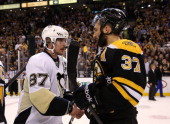 Sidney Crosby of the Pittsburgh Penguins shakes hands with Patrice Bergeron of the Boston Bruins after the Bruins defeated the Penguins 10 in Game...