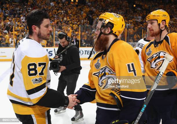 Sidney Crosby of the Pittsburgh Penguins shakes hands with Ryan Ellis of the Nashville Predators after the Penguins defeated the Predators 20 to win...