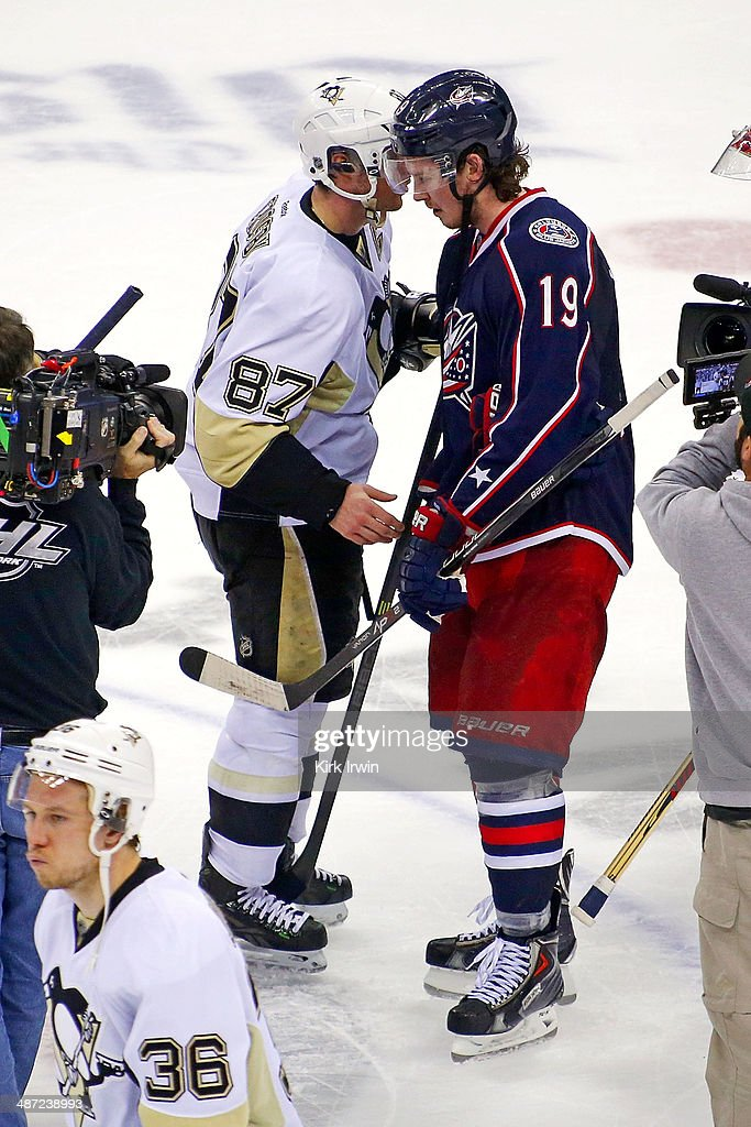 <a gi-track='captionPersonalityLinkClicked' href=/galleries/search?phrase=Sidney+Crosby&family=editorial&specificpeople=212781 ng-click='$event.stopPropagation()'>Sidney Crosby</a> #87 of the Pittsburgh Penguins shakes hands with <a gi-track='captionPersonalityLinkClicked' href=/galleries/search?phrase=Ryan+Johansen&family=editorial&specificpeople=6698841 ng-click='$event.stopPropagation()'>Ryan Johansen</a> #19 of the Columbus Blue Jackets after Pittsburgh defeated Columbus 4-3 to win the series in Game Six of the First Round of the 2014 NHL Stanley Cup Playoffs at Nationwide Arena on April 28, 2014 in Columbus, Ohio.