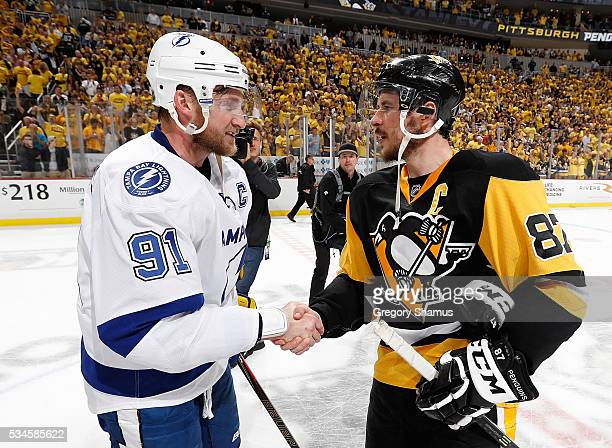 Sidney Crosby of the Pittsburgh Penguins shakes hands with Steven Stamkos of the Tampa Bay Lightning after a 21 win in Game Seven of the Eastern...