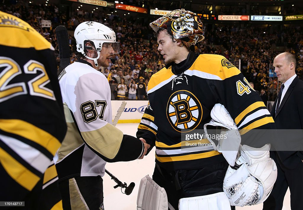<a gi-track='captionPersonalityLinkClicked' href=/galleries/search?phrase=Sidney+Crosby&family=editorial&specificpeople=212781 ng-click='$event.stopPropagation()'>Sidney Crosby</a> #87 of the Pittsburgh Penguins shakes hands with <a gi-track='captionPersonalityLinkClicked' href=/galleries/search?phrase=Tuukka+Rask&family=editorial&specificpeople=716723 ng-click='$event.stopPropagation()'>Tuukka Rask</a> #40 of the Boston Bruins after the Bruins defeated the Penguins 1-0 in Game Four of the Eastern Conference Final during the 2013 NHL Stanley Cup Playoffs at the TD Garden on June 7, 2013 in Boston, United States.