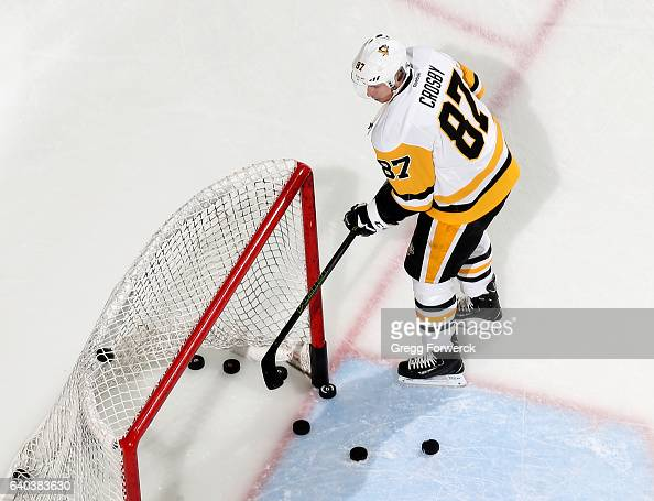 Sidney Crosby of the Pittsburgh Penguins shoots pucks into the net prior to an NHL game against the Carolina Hurricanes on January 20 2017 at PNC...