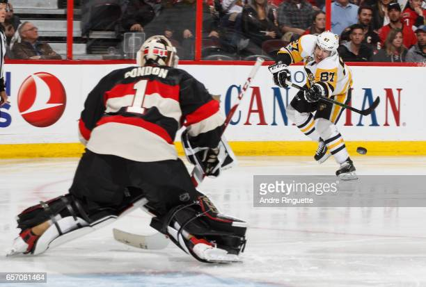 Sidney Crosby of the Pittsburgh Penguins shoots the puck against Mike Condon of the Ottawa Senators at Canadian Tire Centre on March 23 2017 in...