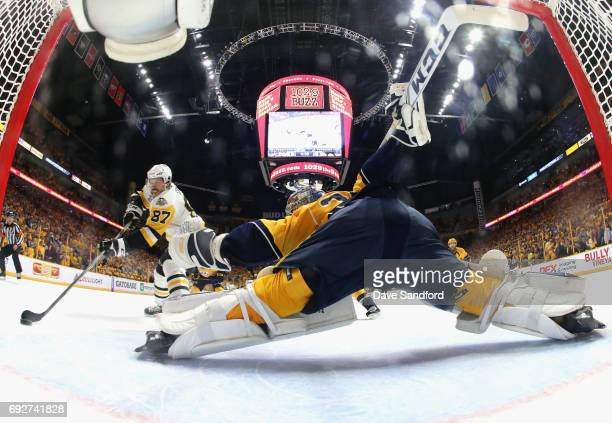 Sidney Crosby of the Pittsburgh Penguins shoots the puck on goaltender Pekka Rinne of the Nashville Predators to score in the first period of Game...