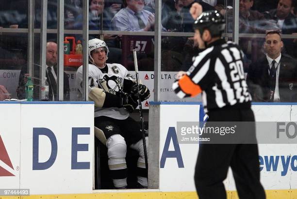 Sidney Crosby of the Pittsburgh Penguins sits in the penalty box against the New York Rangers after referee Tim Peel makes a holding call on March 4...