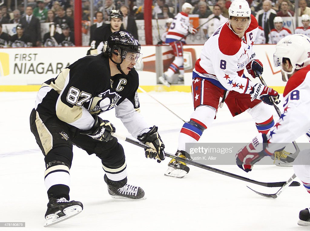 Sidney Crosby #87 of the Pittsburgh Penguins skates against Alex Ovechkin #8 of the Washington Capitals during the game at Consol Energy Center on March 11, 2014 in Pittsburgh, Pennsylvania.