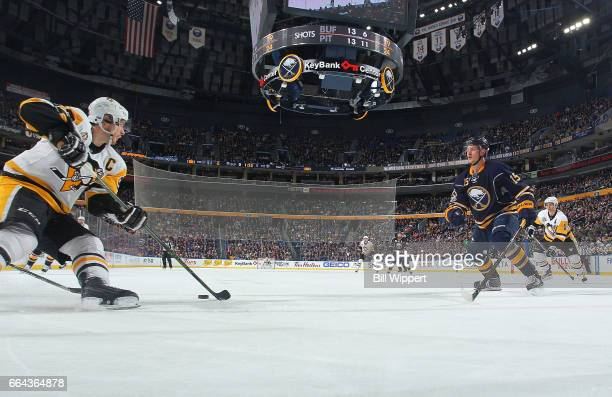 Sidney Crosby of the Pittsburgh Penguins skates against Jack Eichel of the Buffalo Sabres during an NHL game at the KeyBank Center on March 21 2017...