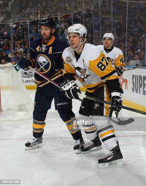 Sidney Crosby of the Pittsburgh Penguins skates against Josh Gorges of the Buffalo Sabres during an NHL game at the KeyBank Center on March 21 2017...