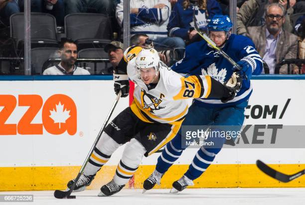 Sidney Crosby of the Pittsburgh Penguins skates against Nikita Zaitsev of the Toronto Maple Leafs during the third period at the Air Canada Centre on...