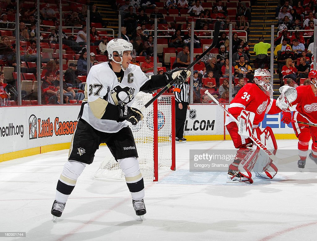 Sidney Crosby #87 of the Pittsburgh Penguins skates against the Detroit Red Wings during a pre season game at Joe Louis Arena on September 25, 2013 in Detroit, Michigan. The Penguins won the game 5-1.