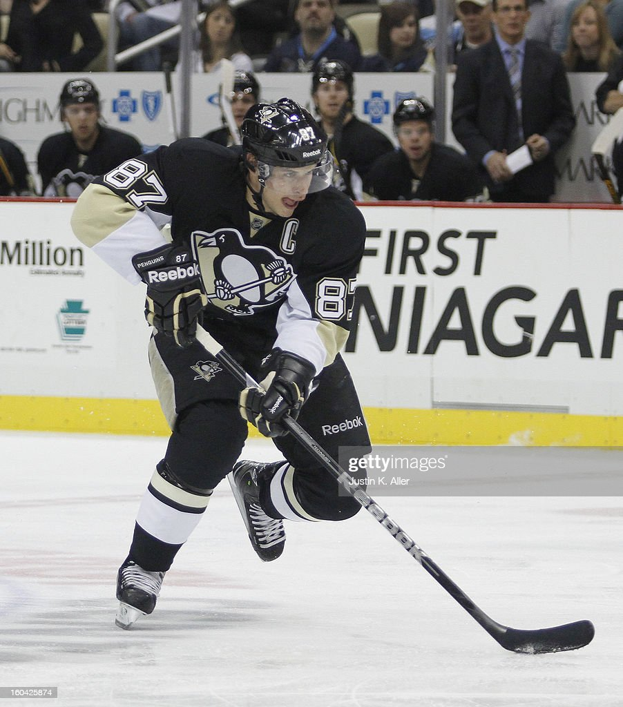 <a gi-track='captionPersonalityLinkClicked' href=/galleries/search?phrase=Sidney+Crosby&family=editorial&specificpeople=212781 ng-click='$event.stopPropagation()'>Sidney Crosby</a> #87 of the Pittsburgh Penguins skates against the New York Islanders during the game at Consol Energy Center on January 29, 2013 in Pittsburgh, Pennsylvania.