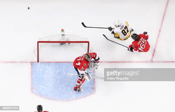 Sidney Crosby of the Pittsburgh Penguins skates behind the net against Craig Anderson and Erik Karlsson of the Ottawa Senators in Game Six of the...