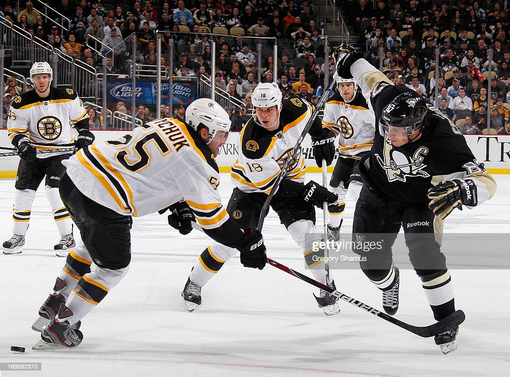 <a gi-track='captionPersonalityLinkClicked' href=/galleries/search?phrase=Sidney+Crosby&family=editorial&specificpeople=212781 ng-click='$event.stopPropagation()'>Sidney Crosby</a> #87 of the Pittsburgh Penguins skates for the loose puck between the defense of <a gi-track='captionPersonalityLinkClicked' href=/galleries/search?phrase=Johnny+Boychuk&family=editorial&specificpeople=2125695 ng-click='$event.stopPropagation()'>Johnny Boychuk</a> #55 and <a gi-track='captionPersonalityLinkClicked' href=/galleries/search?phrase=Nathan+Horton&family=editorial&specificpeople=204741 ng-click='$event.stopPropagation()'>Nathan Horton</a> #18 of the Boston Bruins on March 12, 2013 at Consol Energy Center in Pittsburgh, Pennsylvania. Pittsburgh won the game 3-2.