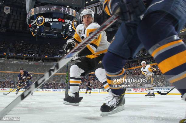 Sidney Crosby of the Pittsburgh Penguins skates for the puck against the Buffalo Sabres at the KeyBank Center on March 21 2017 in Buffalo New York...