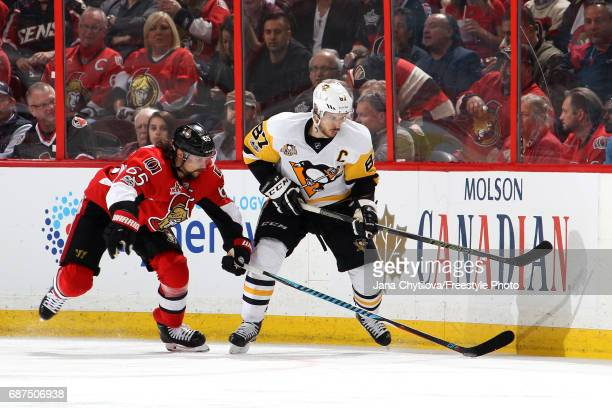 Sidney Crosby of the Pittsburgh Penguins skates for the puck against Erik Karlsson of the Ottawa Senators during the second period in Game Six of the...