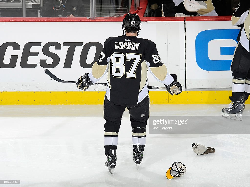 <a gi-track='captionPersonalityLinkClicked' href=/galleries/search?phrase=Sidney+Crosby&family=editorial&specificpeople=212781 ng-click='$event.stopPropagation()'>Sidney Crosby</a> #87 of the Pittsburgh Penguins skates to the bench after his hat trick goal in the second period against the Ottawa Senators in Game Two of the Eastern Conference Semifinals during the 2013 NHL Stanley Cup Playoffs at Consol Energy Center on May 17, 2013 in Pittsburgh, Pennsylvania.