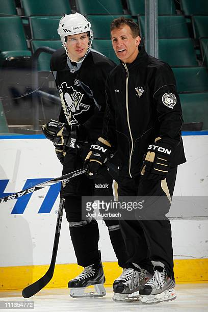 Sidney Crosby of the Pittsburgh Penguins skates with Assistant coach Tony Granato during a team workout on April 1 2011 at the BankAtlantic Center in...