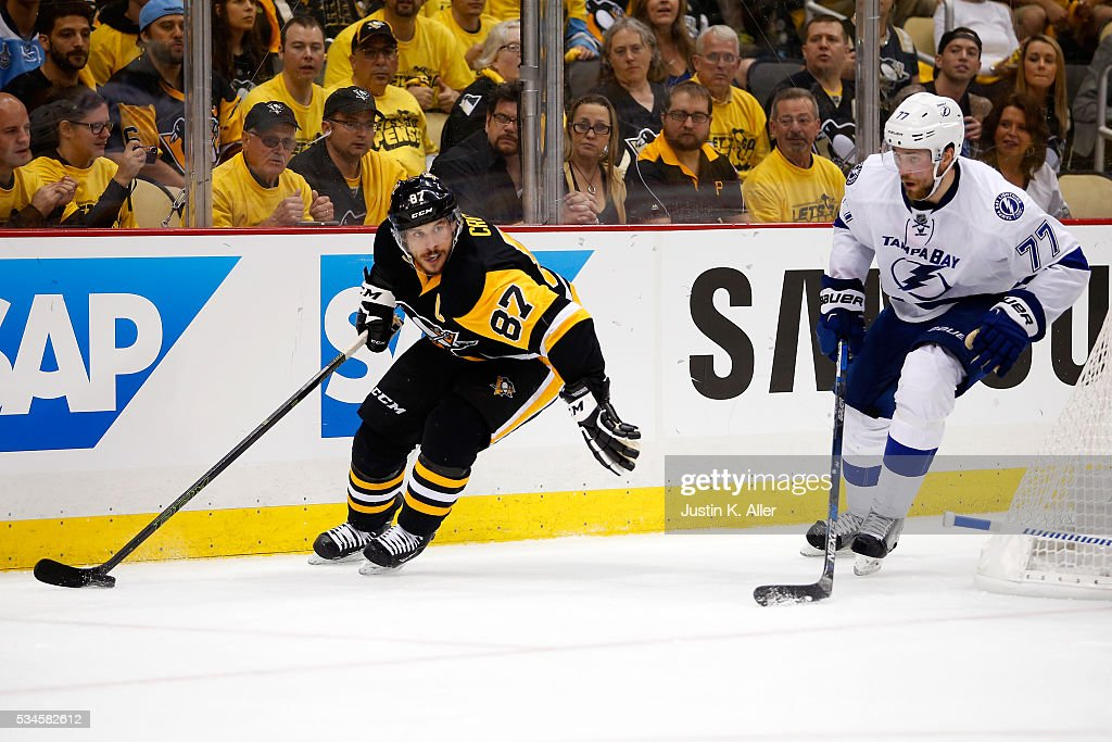 <a gi-track='captionPersonalityLinkClicked' href=/galleries/search?phrase=Sidney+Crosby&family=editorial&specificpeople=212781 ng-click='$event.stopPropagation()'>Sidney Crosby</a> #87 of the Pittsburgh Penguins skates with the puck against <a gi-track='captionPersonalityLinkClicked' href=/galleries/search?phrase=Victor+Hedman&family=editorial&specificpeople=4784238 ng-click='$event.stopPropagation()'>Victor Hedman</a> #77 of the Tampa Bay Lightning during the second period in Game Seven of the Eastern Conference Final during the 2016 NHL Stanley Cup Playoffs at Consol Energy Center on May 26, 2016 in Pittsburgh, Pennsylvania.