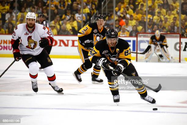 Sidney Crosby of the Pittsburgh Penguins skates with the puck against the Ottawa Senators in Game Five of the Eastern Conference Final during the...