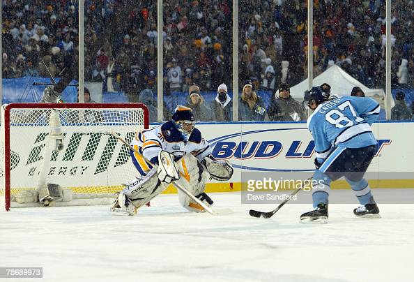 Sidney Crosby of the Pittsburgh Penguins skates with the puck toward goaltender Ryan Miller of the Buffalo Sabres en route to scoring the final shoot...