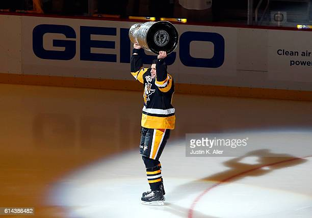 Sidney Crosby of the Pittsburgh Penguins skates with the Stanley Cup before the game against Washington Capitals at PPG Paints Arena on October 13...