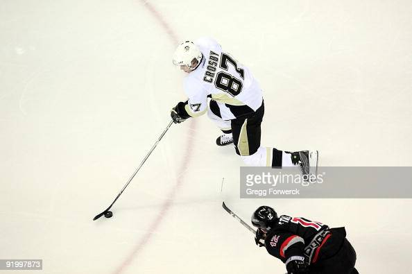 Sidney Crosby of the Pittsburgh Penguins skates witht he puck during a NHL game against the Carolina Hurricanes on October 14 2009 at RBC Center in...