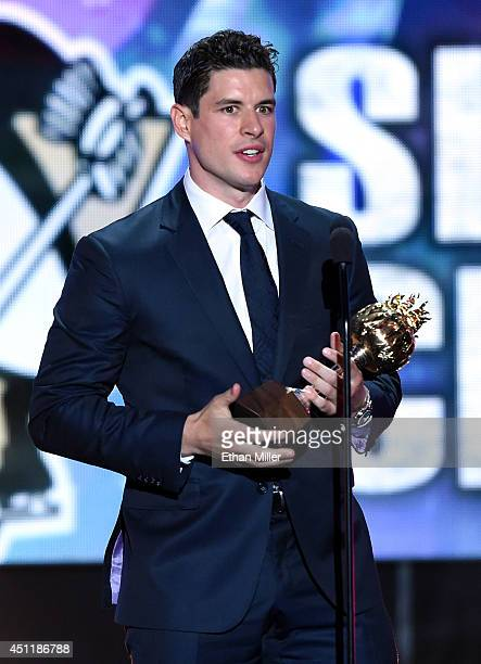 Sidney Crosby of the Pittsburgh Penguins speaks after winning the Hart Memorial Trophy during the 2014 NHL Awards at the Encore Theater at Wynn Las...