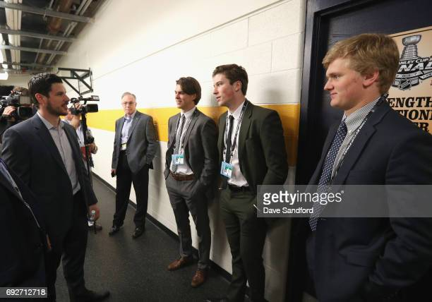 Sidney Crosby of the Pittsburgh Penguins speaks to top prospects Nolan Patrick Nico Hischier and Casey Mittelstadt during the media availability for...
