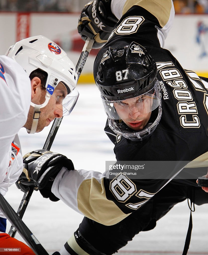 <a gi-track='captionPersonalityLinkClicked' href=/galleries/search?phrase=Sidney+Crosby&family=editorial&specificpeople=212781 ng-click='$event.stopPropagation()'>Sidney Crosby</a> #87 of the Pittsburgh Penguins takes a faceoff against <a gi-track='captionPersonalityLinkClicked' href=/galleries/search?phrase=John+Tavares&family=editorial&specificpeople=601791 ng-click='$event.stopPropagation()'>John Tavares</a> #91 of the New York Islanders in Game Two of the Eastern Conference Quarterfinals during the 2013 NHL Stanley Cup Playoffs at Consol Energy Center on May 3, 2013 in Pittsburgh, Pennsylvania. New York won the game 4-3.