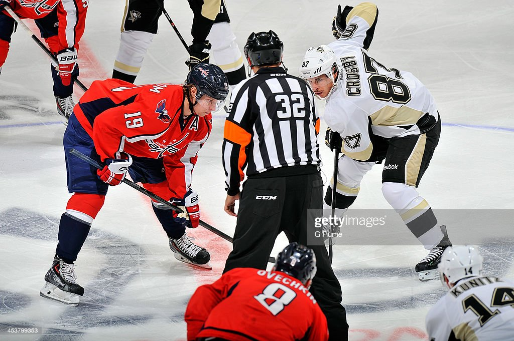 Sidney Crosby of the Pittsburgh Penguins takes a faceoff against Nicklas Backstrom of the Washington Capitals at the Verizon Center on November 20...