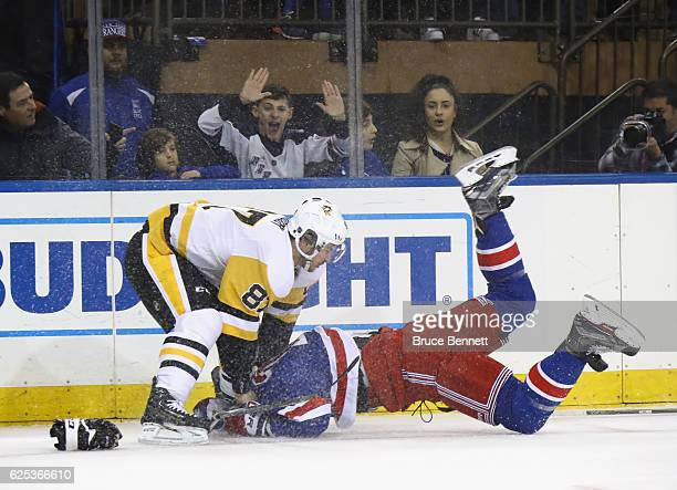 Sidney Crosby of the Pittsburgh Penguins takes a first period roughing penalty against Ryan McDonagh of the New York Rangers at Madison Square Garden...