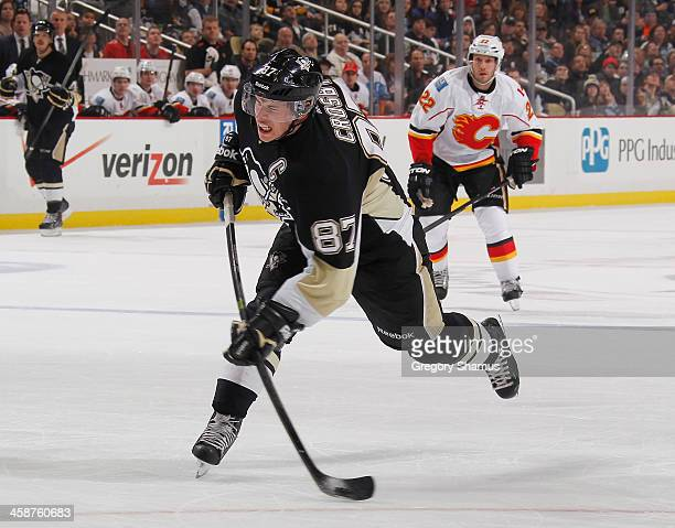 Sidney Crosby of the Pittsburgh Penguins takes a shot and scores during the second period against the Calgary Flames on December 21 2013 at Consol...
