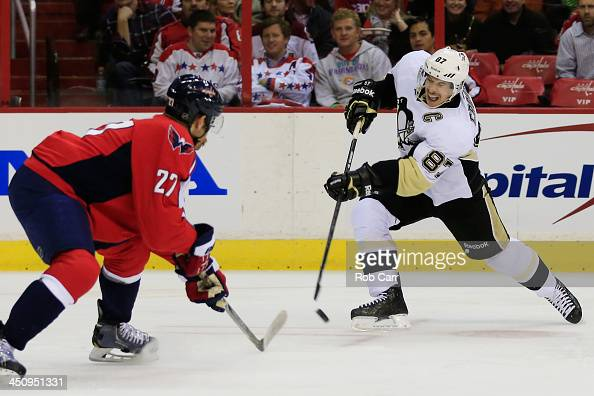 Sidney Crosby of the Pittsburgh Penguins takes a shot of goal in front of Karl Alzner of the Washington Capitals during the second period at Verizon...