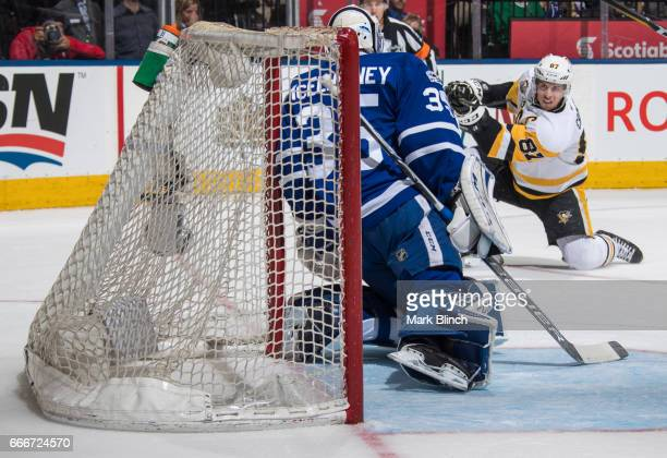 Sidney Crosby of the Pittsburgh Penguins takes a shot on Curtis McElhinney of the Toronto Maple Leafs during the second period at the Air Canada...