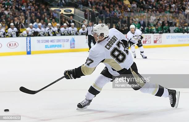 Sidney Crosby of the Pittsburgh Penguins takes a shot on goal against the Dallas Stars in the second period at American Airlines Center on January 25...