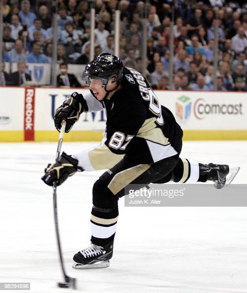 Sidney Crosby of the Pittsburgh Penguins takes a shot on goal in the first period at Mellon Arena on April 6 2009 in Pittsburgh Pennsylvania