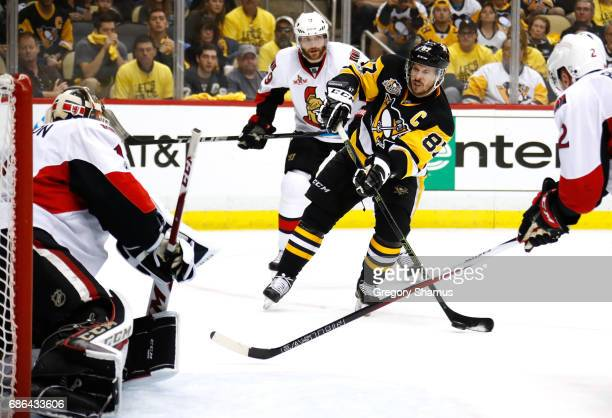 Sidney Crosby of the Pittsburgh Penguins takes a shot on Mike Condon of the Ottawa Senators during the second period in Game Five of the Eastern...