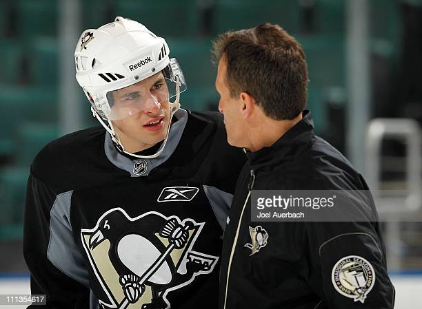 Sidney Crosby of the Pittsburgh Penguins talks to assistant coach Tony Granato during a team workout on April 1 2011 at the BankAtlantic Center in...