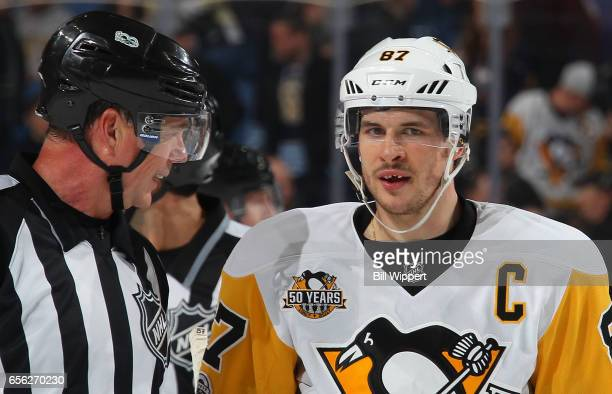 Sidney Crosby of the Pittsburgh Penguins talks to referee Mike Leggo after being highsticked in the mouth late in their NHL game against the Buffalo...