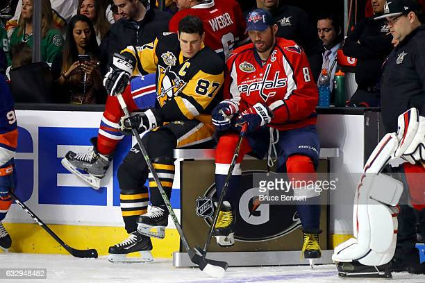 Sidney Crosby of the Pittsburgh Penguins talks with Alex Ovechkin of the Washington Capitals in the Gatorade NHL Skills Challenge Relay during the...
