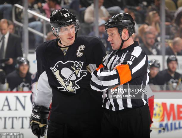 Sidney Crosby of the Pittsburgh Penguins talks with Referee Kelly Sutherland during the game against the Columbus Blue Jackets on November 1 2013 at...