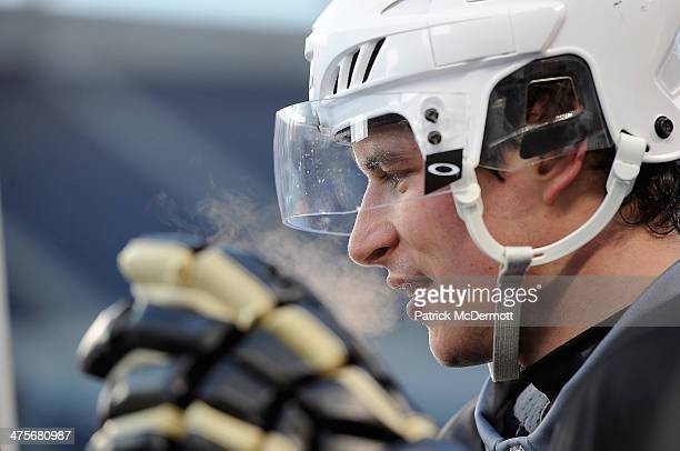 Sidney Crosby of the Pittsburgh Penguins talks with the NHL Network during the 2014 NHL Stadium Series practice day on February 28 2014 at Soldier...