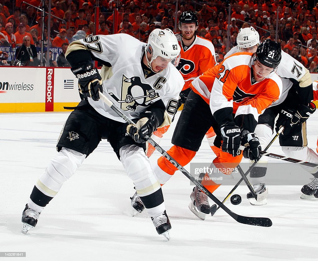 Sidney Crosby #87 of the Pittsburgh Penguins tries to control the puck as James van Riemsdyk #21 of the Philadelphia Flyers tries to get it in the first period of Game Six of the Eastern Conference Quarterfinals during the 2012 NHL Stanley Cup Playoffs at Wells Fargo Center on April 22, 2012 in Philadelphia, Pennsylvania.