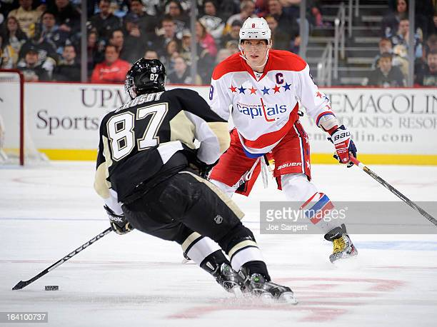 Sidney Crosby of the Pittsburgh Penguins tries to get past the defense of Alex Ovechkin of the Washington Capitals on March 19 2013 at Consol Energy...