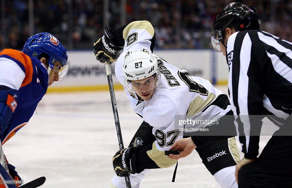 <a gi-track='captionPersonalityLinkClicked' href=/galleries/search?phrase=Sidney+Crosby&family=editorial&specificpeople=212781 ng-click='$event.stopPropagation()'>Sidney Crosby</a> #87 of the Pittsburgh Penguins waits for the referee to drop the box on a faceoff against <a gi-track='captionPersonalityLinkClicked' href=/galleries/search?phrase=Marty+Reasoner&family=editorial&specificpeople=203281 ng-click='$event.stopPropagation()'>Marty Reasoner</a> #16 of the New York Islanders at Nassau Veterans Memorial Coliseum on March 29, 2012 in Uniondale, New York.