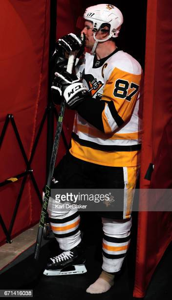 Sidney Crosby of the Pittsburgh Penguins waits in the team tunnel for a skate repair during an NHL game against the Carolina Hurricanes on February...